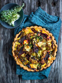 Mini polenta quiche with beetroot, chard and kale