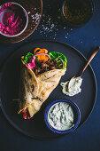 Vegan 'Pulled jackfruit' shawarmas with vegan tzatziki