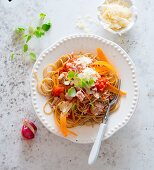 Spaghetti with tuna, tomatoes, carrots and Parmesan cheese