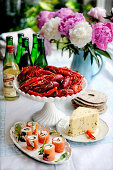 A buffet with crayfish, cheese and salmon rolls