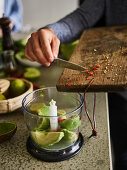 Guacamole being made in a mixer