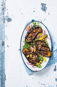 Whole roasted brinjals with oranges and olives