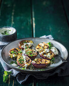 Grilled brinjals with tahini, yoghurt and mint