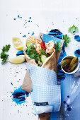 Greek barbecue prawn souva, yoghurt and cucumber