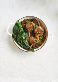 Veal with mushrooms and tuscan kale