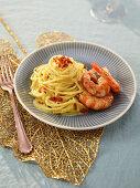 Spaghetti with shrimp-saffron sauce and shrimps