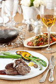 Beef fillets with sauce, asparagus and squash for the Jewish New Year