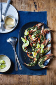 Grilled king prawns with rosemary and lime butter