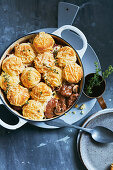 Beef bourguignon with cheesy scone dumplings
