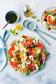 Ravioli caprese salad with salmoriglio dressing