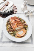 Salmon roulade with shrimp cream and cod, with stuffed onions