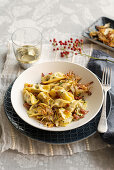 Veal ravioli with ham and fried artichokes