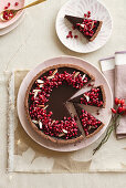 Rice and almond tart with earl grey-chocolate ganache and pomegranate seeds