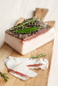 Lard covered with herbs