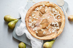 Tart with poached pears and almond frangipane
