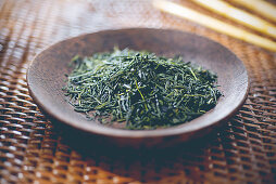 Loose green tea on a plate