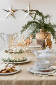Cake on festively set table in natural shades