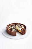 Cheesecake with malt sticks, cream and grated chocolate (Australia)