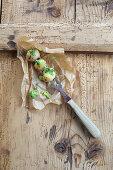 Mini potato dumplings with roast onions on a carving fork