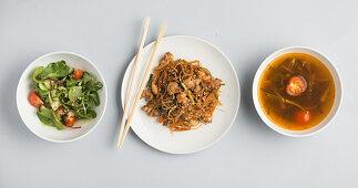 Vegetable salad, a noodle dish and miso soup (Japan)