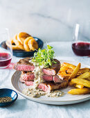 Rump steak with Madagascan peppercorn sauce and duck fat chips