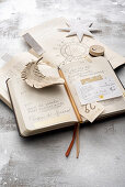 Open diary and star decoration on top of astrology book