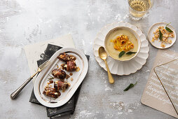 Stuffed dates wrapped in ham coat with a honey and balsamic glaze, and cauliflower soup with saffron and hazelnut butter