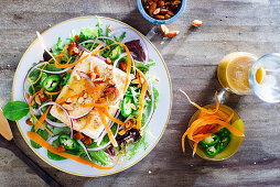 Marinated tofu salad with spicy peanut vinaigrette, sliced jalepenos, carrots, red onion and almonds