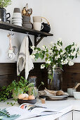 Bouquet of mock orange branches in rustic kitchen