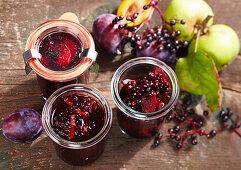 Homemade stewed elderbetrries (plum compote with elderberries, apple, orange juice, red wine, spices)