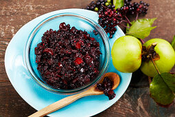 Homemade savory elderberry chutney in a glass bowl