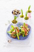 Toast with green asparagus, lentils, Parma ham, quail's eggs and basil mayonnaise