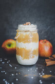 A layered dessert made from apple compote and rice pudding with cinnamon