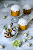 Easter arrangement of easter cake, eggs decorated with dried flowers and candy in the form of eggs