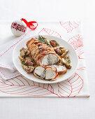 Rana pescatrice porchettata (monk fish wrapped in bacon, Italy)