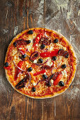 Pizza Greek style with olives, bell pepper and feta