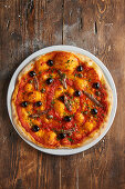 Pizza Napoli with anchovies and olives