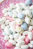 Speckled and plain sugar eggs on plate