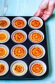 Dough for muffins with slices of red orange