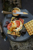 Waffles with Camembert and tomatoes