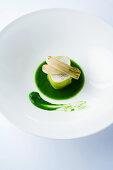 Fish wrapped in leeks on green leek puree