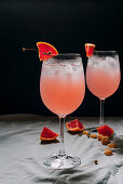Cocktail grapefruit, alcoholic beverage with tropical fruits lavender and ice flowers