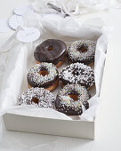 Doughnuts with chocolate glaze and sugar sprinkles as a gift