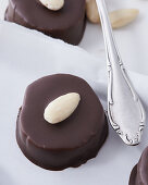 A marzipan nougat biscuit with chocolate glaze, close-up