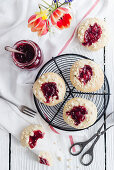 Jam cheesecake and yeast biscuits with sprinkles
