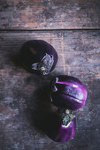 Round eggplants on a wooden surface