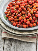 Fresh rosehips on a metal plate