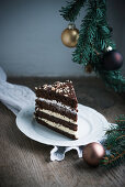 A piece of vegan hazelnut and chocolate buttercream cake with Christmas decoration