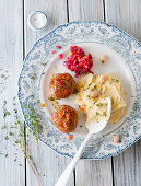 Meatballs with bean purée and beetroot salad
