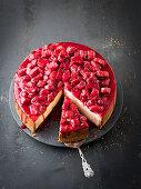 Rhubarb and raspberry cheesecake, sliced